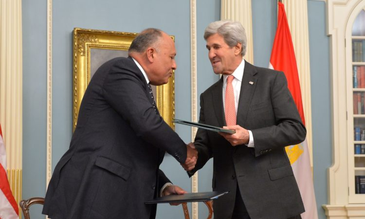 U.S. Secretary of State John Kerry and Egyptian Foreign Minister Sameh Shoukry shake hands after signing a U.S.-Egypt cultural property agreement, at the U.S. Department of State in Washington, D.C., on November 30, 2016. [State Department photo/ Public Domain]