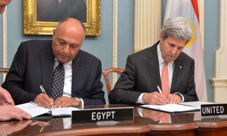 U.S. Secretary of State John Kerry and Egyptian Foreign Minister Sameh Shoukry sign a U.S.-Egypt cultural property agreement