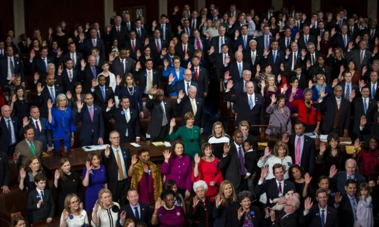 Lawmakers stand while being sworn into office during the opening of the 116th Congress in Washington. (© Al Drago/Bloomberg/Getty Images)