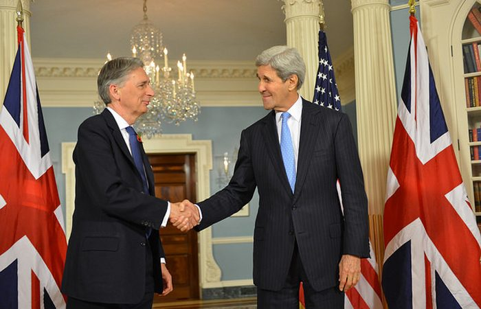 Secretaries Kerry & Hammond shake hands in D.C.
