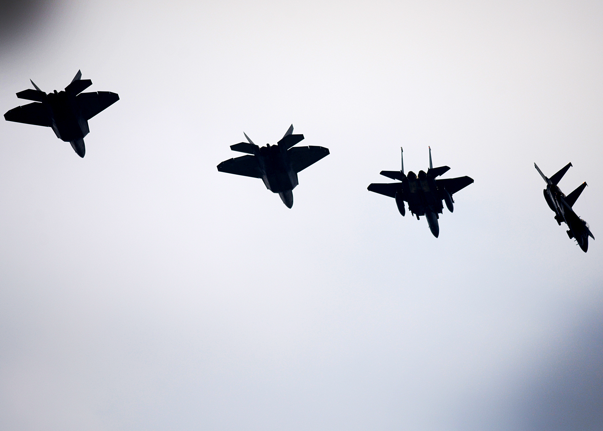 F-22 Raptors from the 95th Fighter Squadron conduct air-to