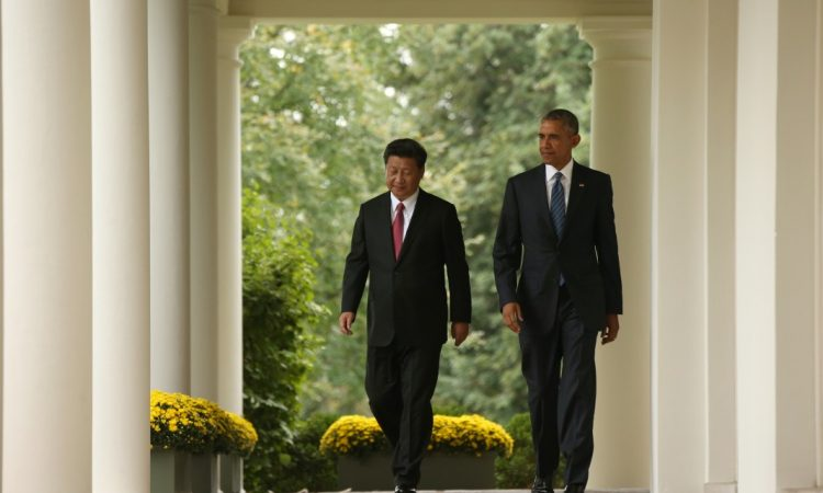 President Obama and President Xi Jinping of China walk along the Colonnade of the White House on September 25, 2015.
