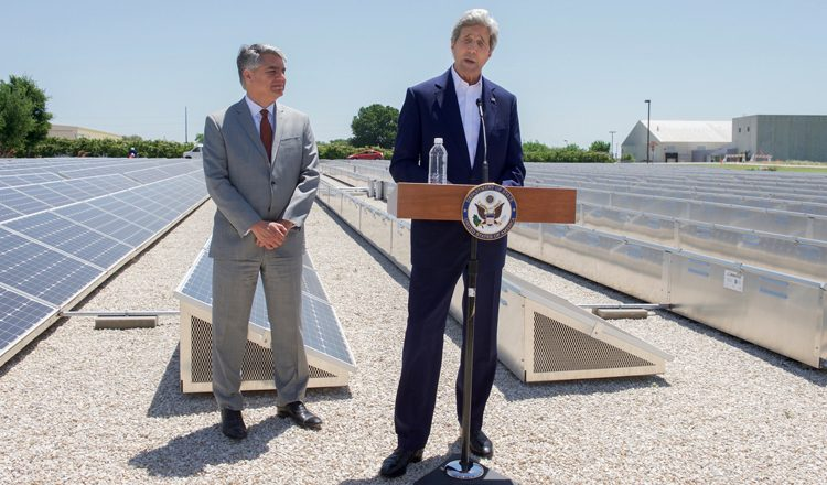 Secretary Kerry and University of Texas at Austin President Fenves Stand in Front of a Solar Field as They Deliver Remarks Following a Business Roundtable on Clean Energy in Austin