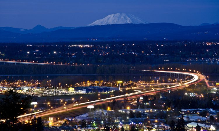 Portland, Oregon, at night, with Mount Hood in the distance. (Shutterstock)