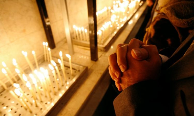 A pair of hands clasped in prayer