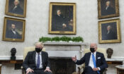 President Joe Biden, right, speaks during a meeting with British Prime Minister Boris Johnson in the Oval Office of the White House, Tuesday, Sept. 21, 2021, in Washington.