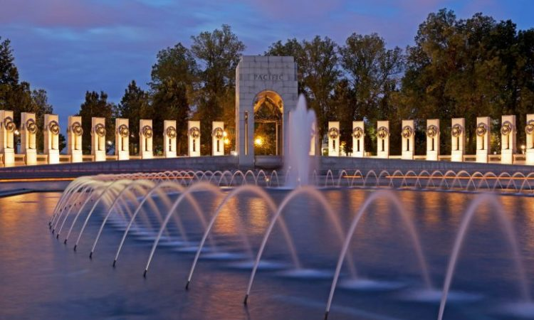 The National World War II Memorial in Washington illuminated at dusk