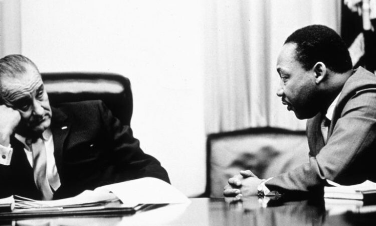 President Johnson discusses the Voting Rights Act with civil rights leader Martin Luther King Jr.