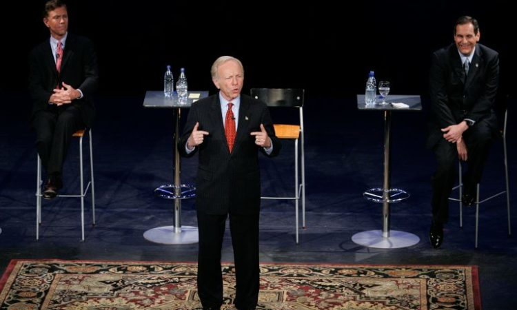 Joe Lieberman, while running as an independent, speaks at a 2006 debate in Connecticut, with Democratic Party–endorsed candidate Ned Lamont, left, and Republican Alan Schlesinger. (© Bob Child/AP Images)