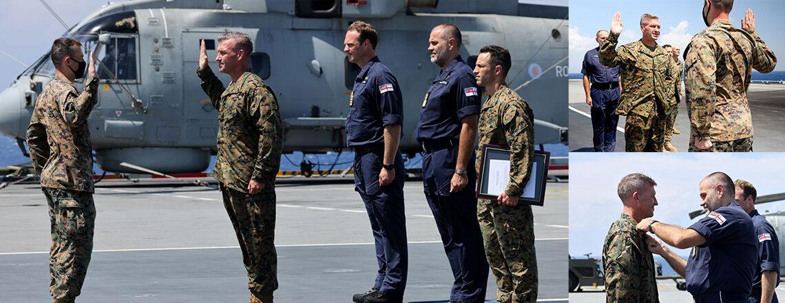 Royal Navy Frocks U.S. Marine General aboard UK's HMS Queen Elizabeth Aircraft Carrier
