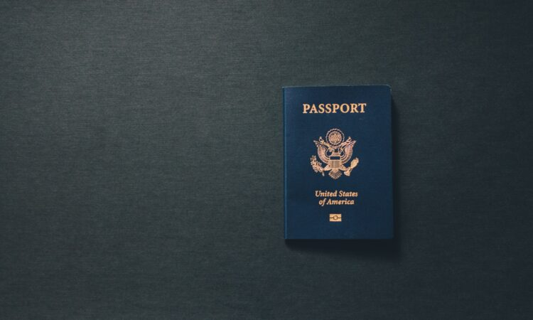 A U.S> passport on a charcoal gray background