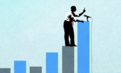 Man standing on bar charts