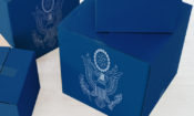 Cardboard boxes warpped in the US State Seal