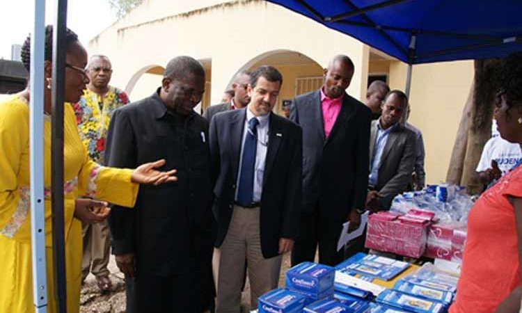 The Secretary General of the Health Ministry, Dr. Mukengeshayi Kupa and USAID Deputy Mission Director Christophe Tocco visit a stand of Family Planning and water purification products that will be promoted through SIFPO (State Dept photos).