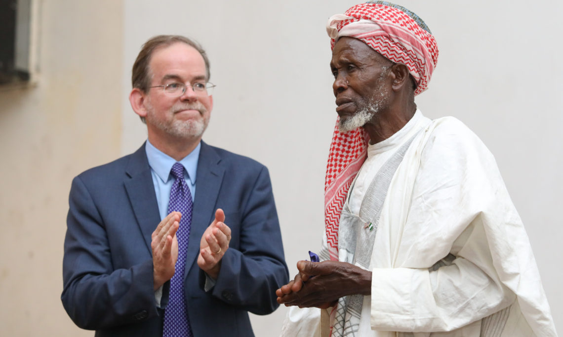 Charge d' Affaires, David Young applaud Imam Abubakar at the premiere of Sowing Hope in Jos