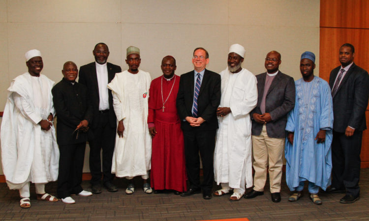 Charge d' Affairs, David Young, with religious leaders and members of the InterFaith Mediation Centre following their meeting