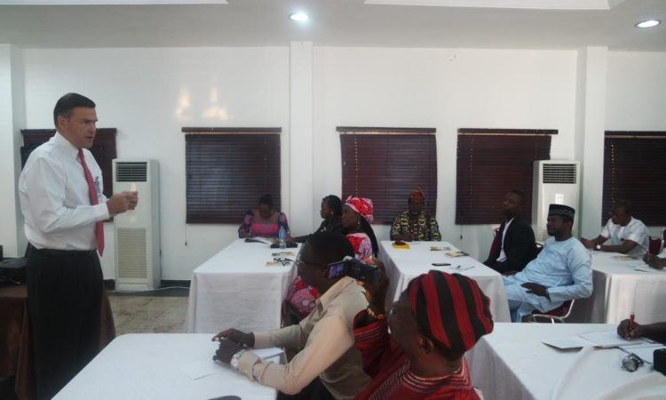 Ambassador Syminton interacting with U.S. government exchange alumni at the workshop in Abuja. U.S. Embassy photo