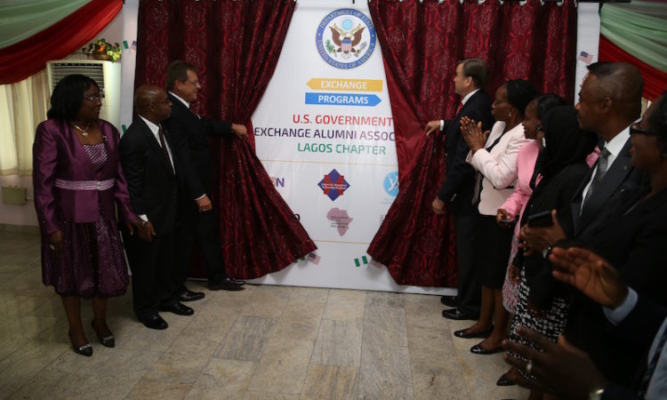 Ambassador Symington and Consul General Bray unveiling exchange alumni association banner
