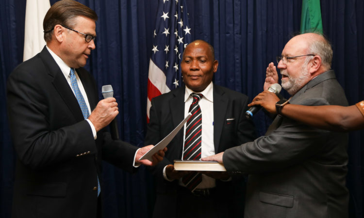 Ambassador W Stuart Symington swears in the new USAID Mission Director, Stephen Haykin. Photo Credit: US Embassy/Ola Aworinde