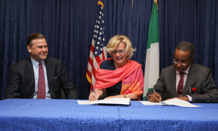 US Global AIDS Coordinator, Ambassador Deborah Birx and DG NACA, Dr Sani Aliyu, sign the Nigeria HIV AIDS COP 2017 while Ambassador Symington looks on. Photo: U.S. Embassy/Ola Aworinde