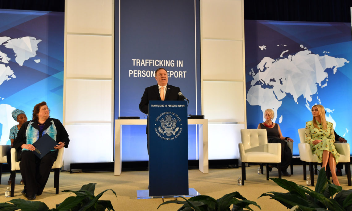 U.S. Secretary of State Mike Pompeo, flanked by Advisor to the President Ivanka Trump and the ten 2018 'TIP Report Heroes', delivers remarks on the release of the State Department's annual Trafficking in Persons report at the U.S. Department of State on June 28, 2018. (State Department photo/ Public Domain)