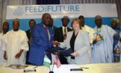 U.S. Chargé d'affaires Kathleen FitzGibbon (right) signs a Declaration of Partnership for the U.S. Feed the Future Nigeria Country Plan with Mr. Ernest A. Umakhihe, Permanent Secretary, Ministry of Budget and National Planning (left) and witnessed by Kebbi State Governor, Abubakar Atiku Bagudu, deputy governors and other officials. The Plan will boost agri-business, resilience, and nutrition in 11 states of Nigeria.