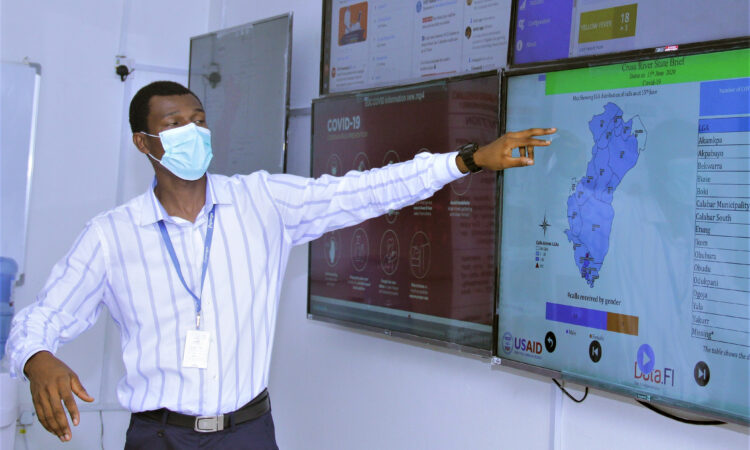 Dr. Douglas Chukwu, Cross River State team lead for USAID partner Jhpiego, conducts a virtual tour of the new Emergency Operations Center for U.S. Ambassador Mary Beth Leonard and Cross River Deputy Governor Evara Esu.