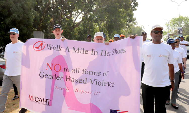 "Country Public Affairs Officer Aruna Amirthanayagam participates in the ""Walk a Mile in Her Shoes"" event in Abuja in support of the campaign against gender based violence"