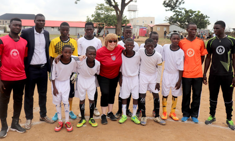 U.S. Embassy Chargé d'Affaires Kathleen FitzGibbon with a team of the Soccer Buddy tournament in Abuja. Photo Credit: U.S. Embassy Abuja/Adediran Adegoke