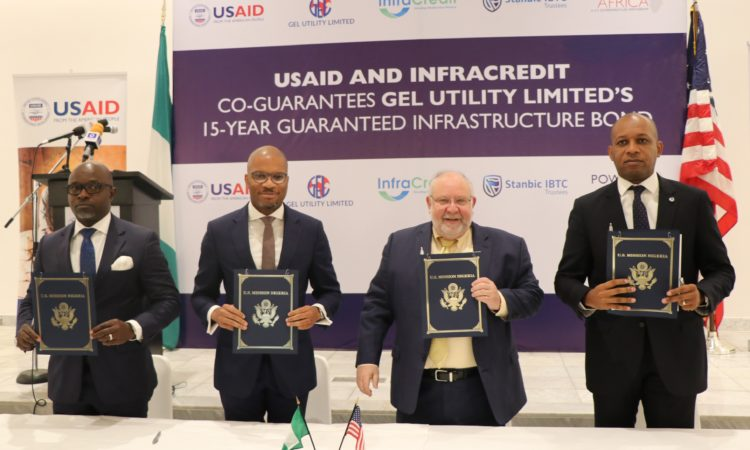 USAID Mission Director Stephen M. Haykin (second right) with bond partnership signees (from left) Felix Achibiri, Alternate Chairman GEL Utility Limited; Chinua Azubike, Chief Executive Officer, InfraCredit; and Charles Omoera, Chief Executive Officer, Stanbic IBTC Trustees.