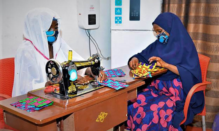 With support from USAID, widowed and vulnerable women from Nigeria's Borno State are being trained to produce more than 50,000 protective masks to prevent the spread of COVID-19 in the coming weeks. Photo: Bassey Aniebiet Akpanudoh/NLCB