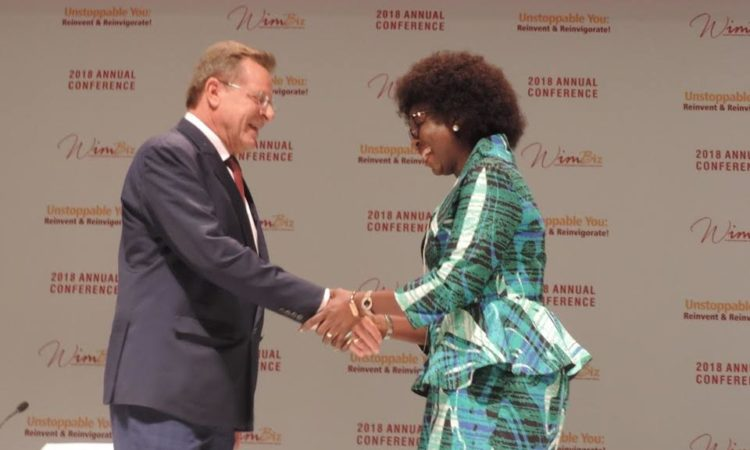 United States Consul General F. John Bray (left) exchanging pleasantries with Chairman, Board of Trustees, WIMBIZ, Ms. Funmi Roberts during the 17th Annual Conference of WIMBIZ, on Friday, November 2.