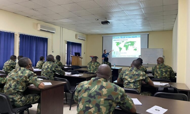 U.S. Coast Guard Instructor, LT Brandon Taylor, providing training on United Nations Convention on the Law of the Sea during the training program in Lagos.