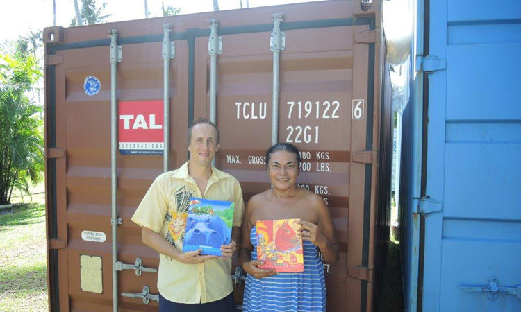Ben Harding from U.S. Embassy Apia with Louise Main from the Rotary Club of Apia, holding some of the books that arrived from the U.S. Photo credit: U.S. State Department.