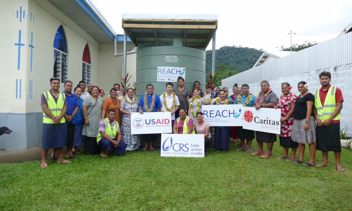 U.S. Embassy Chargé d'Affaires Jonathan Lee Yoo was welcomed by the community of Moamoa Fou celebrating the opening of the newly installed water tank through a ribbon cutting ceremony. Photo credit: U.S. Department of State.