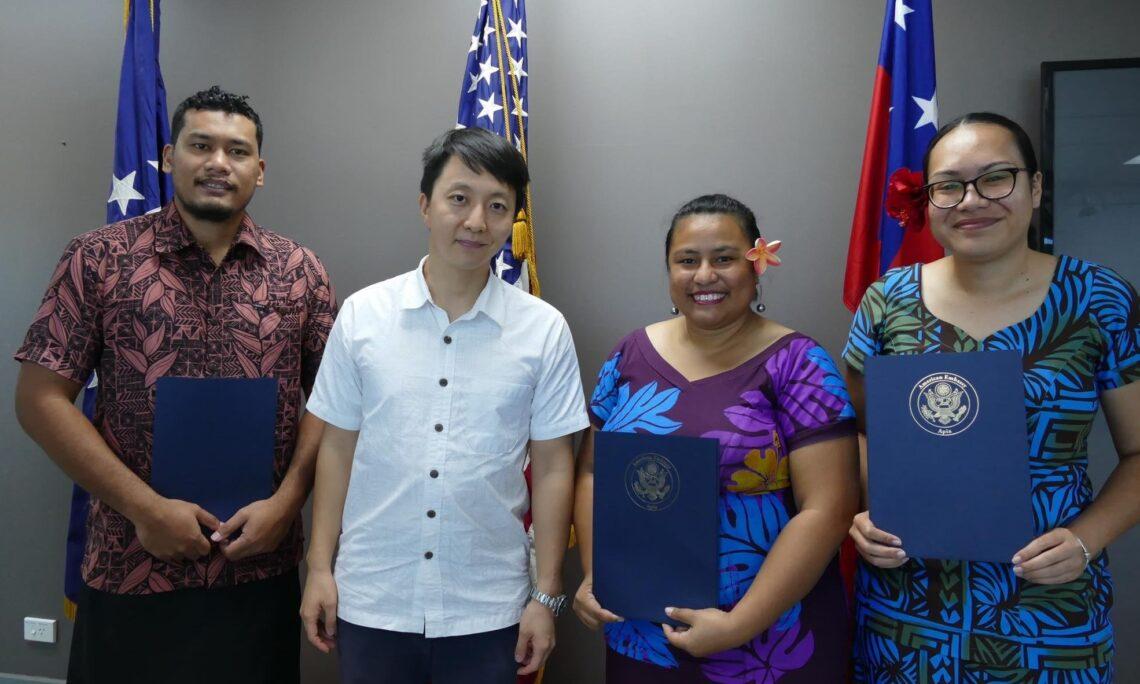 International Visitor Leadership Program recipients congratulated. Photo credit: U.S. Department of State.