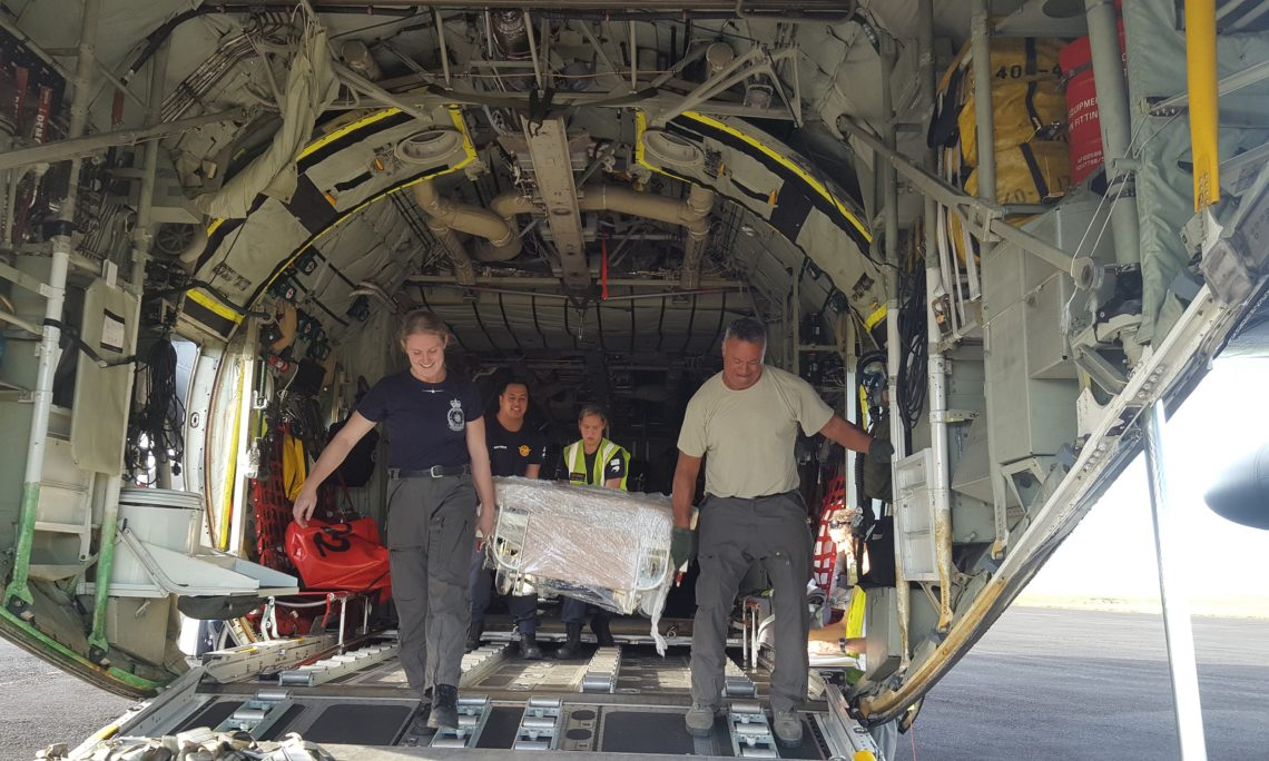 Air Loadmasters Corporal Toni Thompson (left) and Flight Sergeant Destry Tumataiki, from the Royal New Zealand Air Force's No.40 Squadron, help offload half a tonne of hospital equipment donated by the United States Indo-Pacific Command and US Embassy Wellington to Tupua Tamasese Meaole Hospital, Samoa's main hospital.