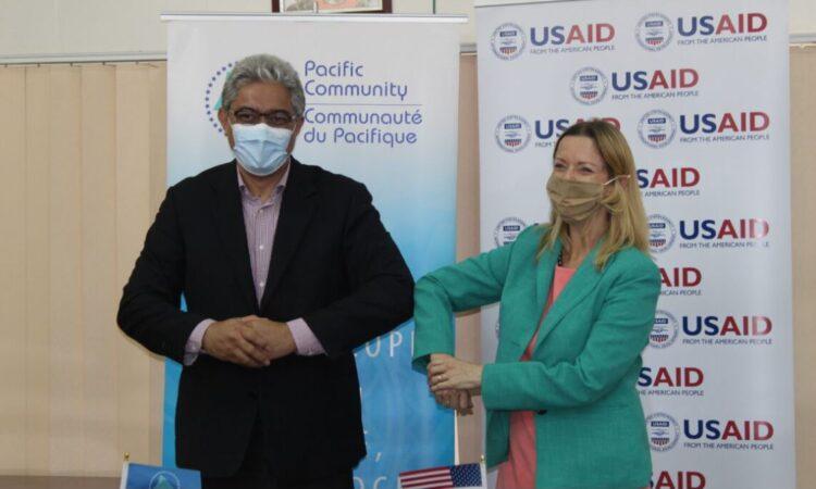 Acting CDA, Miriam Elise Tokumasu de Silva and SPC's Director General Dr. Paula Vivili at the Launch of USAID's PROJECT Governance.