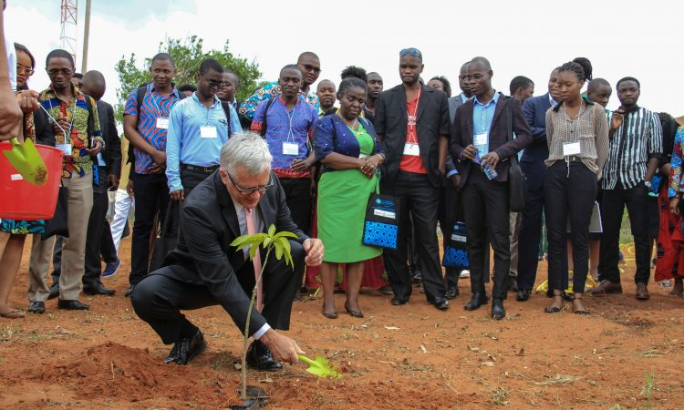 Ambassador Pittman planting a tree at the First Cohort Opening Event of YALI RLCenter in Maputo