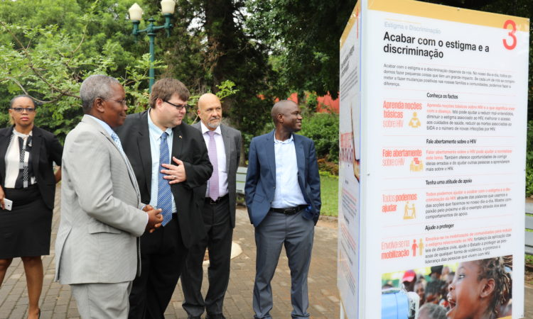 Dr. Zacarias Zindoga, Permanent Secretary for MISAU, and Bryan Hunt, Chargé d'Affaires for the U.S. Embassy, review a display during the inauguration of an exhibition celebrating the 15th anniversary of PEPFAR in Mozambique. Also pictured are Dr. Alfredo Vergara, CDC and Dr.Francisco Mbofana, CNCS.