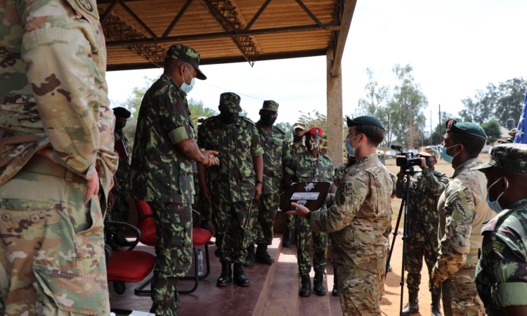 Militaries wearing uniforms and standing and talking