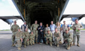 Major General James D. Craig, the Commanding General of Combined Joint Task Force – Horn of Africa, and U.S. Ambassador to Mozambique Dennis W. Hearne pose with members of the U.S. Government's Disaster Assistance Response Team (DART) and the flight crew of a U.S. military aircraft that will deliver humanitarian assistance commodities to Mozambicans impacted by Cyclone Idai.