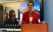 Lady standing at podium. (Embassy Image)