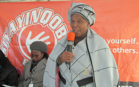 A traditional leader encourages people to step forward and test for HIV.