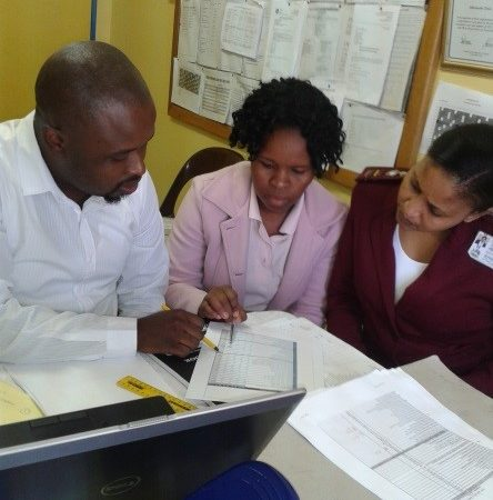 BroachReach's Londa Khungo reviewing data with Mthimude Clinic's Data Capturer S'thembile Ntobela, and Operational Manager Gugu Mbanjwa.