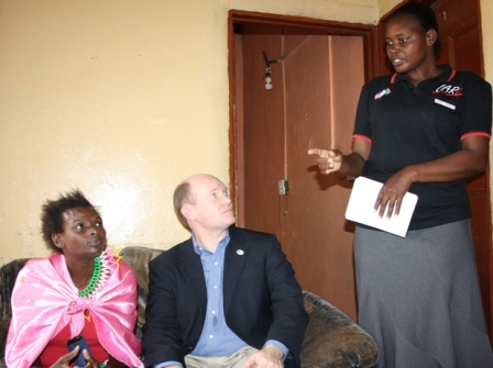 Home-based care giver Nelivia Moyo explains to Senator Coons, the condition in which she found Patricia before being given ARVs and psychological support.