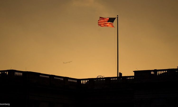 Image of US Flag over the US Capitol