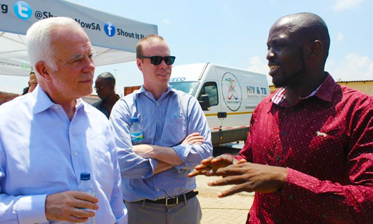 Shout-It-Now site manager, Norman Ngobeni, explains site operations to Consul General Rowan and Economic Officer Hagan Maroney.