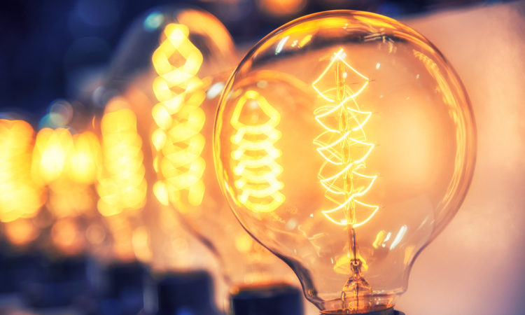 Lightbulbs with lit filaments visible (© Shutterstock)