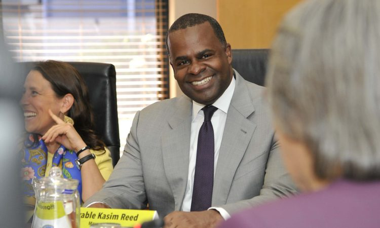 Atlanta Mayor Kasim Reed attends a meeting with Cape Town Mayor Patricia de Lille in South Africa. He was accompanied by Chargé d'Affaires Jessye Lapenn. Photo: City of Cape Town / Bruce Sutherland
